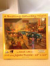 "NIB Sandi LeBron ""A Bustling Saturday Night"" 500 Piece Jigsaw Puzzle 18"" x 24"""