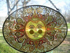 "Amia Suncatcher Oval Translucent Glass- Sun Face/ Solar Rays- Hanging-7""x 5 1/8"""