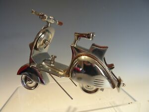 POLISHED STEEL AND LEATHERED VESPA LAMBRETTA SCOOTER MODEL