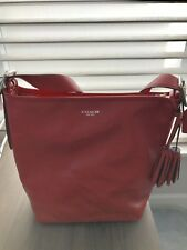 New Coach leather handbag Carnelian Color tags attached