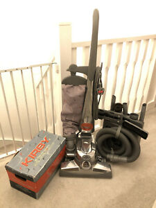 KIRBY SENTRIA VACUUM CLEANER WITH CADDY, TOOLS, HOSE & SHAMPOOER.