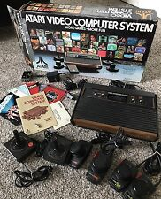 Atari 2600 CX2600-A with original box, and 8 games