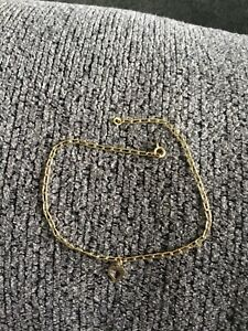 """14k Yellow Gold 9"""" 2mm Bracelet/Anklet With A Gold Heart Charm"""