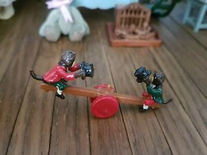 Dolls house Warwick Miniatures metal painted see saw with monkeys articulated .