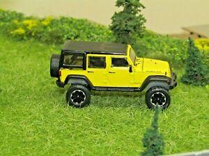 dcp/greenlight CUSTOM Lifted black/yellow Jeep Wrangler 1/64