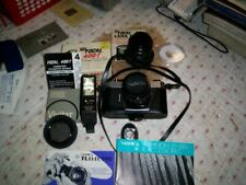 Yashica Tl Electro Film Camera with 2 lenses + flash + filter + books