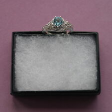BEAUTIFUL SILVER RING WITH FACETED AQUAMARINE GEMS  2.3 GRAM SIZE O AND Q IN BOX