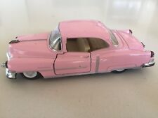 Kinsmart pull-back 1953 Cadillac Series 62 1:43 scale (pink)