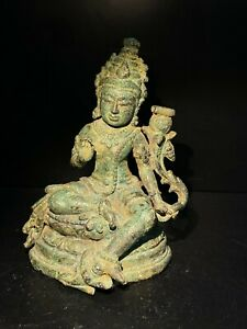 old ancient antique green Tara bronze statue from south east Asia