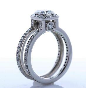 * RITANI * 18K White Gold and Diamond Halo Setting (Size -5.75)