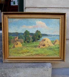 Haystacks by Scandinavian fjord. Signed. Ca 1930s. Fine salon  oil.
