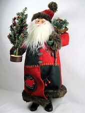 Nature loving Outdoor Santa figure doll Carrying snowshoes and small pine tree