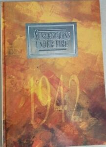 1942 AUSTRALIA UNDER FIRE - BOOK WITH STAMPS AND POSTCARDS