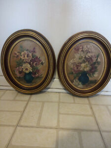 A pair of oval flural oil on board painting signed Edna Lewis