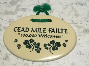 """Mountain Meadows Pottery  5.75"""" x 3.75"""" Gaelic Oval Plaque """"100,000 Welcomes"""""""