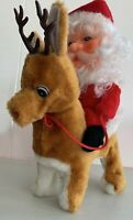 VINTAGE CHRISTMAS SANTA CLAUS RIDING RUDOLPH ANIMATED ELECTRONIC MUSICAL PLUSH