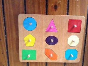 HANDMADE WOODEN  SHAPES WITH NOBS PUZZLE