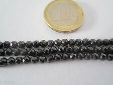 1 filo di zirconi color nero forati e sfaccettati di 3,2x2,5 mm  lungo 37 cm