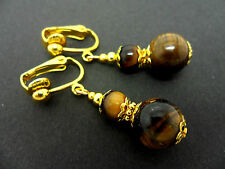 A PAIR OF TIGERS EYE  GOLD PLATED DROP DANGLY CLIP ON  EARRINGS. NEW.