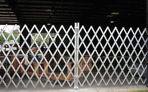 Folding Gate Scissor Gate - Double fixed folding security Gate 14' x 6'