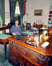 """PRESIDENT JOHN F. KENNEDY SITS AT THE """"RESOLUTE DESK"""" - 8X10 PHOTO (ZY-434)"""