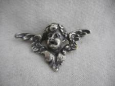 Vintage silver plated winged cherub pin