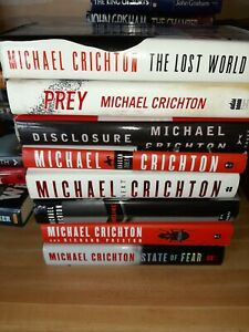 Lot of 8 Michael Crichton Hardcover with dust covers all 1st edition.