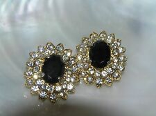 Estate Clear Rhinestone with Oval Faceted Black Center Cab Goldtone Flower Clip