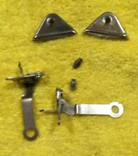 A pair of standard gauge Lionel pins, couplers and triangles