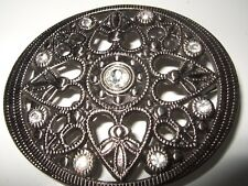 3 1/4 inch -  2 3/4 inch silver coloured  oval metal   buckle with stone details