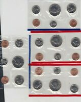 FOUR 1990 US MINT UNCIRCULATED SIX COIN SETS IN NEAR MINT CONDITION.