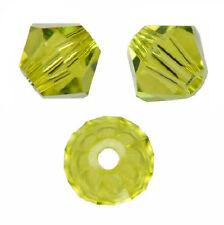 100 Perles Toupies 4mm  Cristal de Swarovski véritable - light Olivine