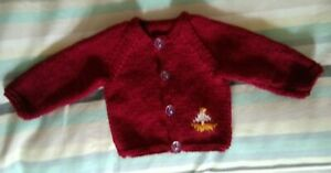 Hand-knitted small newborn round-neck baby cardigan in red wine with boat motif.