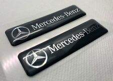2x Mercedes-Benz Black Logo 3D Domed Stickers. Size 65x17mm.