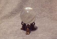 Antique glass crystal witch ball on brass figural triple cherubim stand