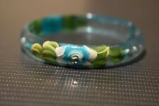Bracelet. Hand painted with floral design and embossed with sparkly crystals.