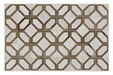 Patchwork Teppich aus braun-weißem Kuhfell - 150cm x 100cm