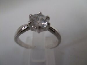18KT WHITE GOLD and SILVER SWAROVSKY SOLITAIRE and WHITE TOPAZ ACCENTS RING SZ M