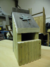 Selection of bird boxes made from recycled timber