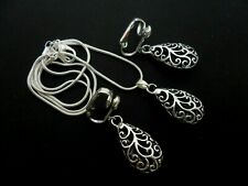A TIBETAN SILVER FILIGREE TEARDROP THEMED NECKLACE AND CLIP ON EARRING SET. NEW.