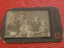 ANTIQUE BLACK AND WHITE PHOTOGRAPH OF A FAMILY WITH A BABY DOLL