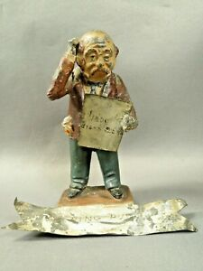 Heyde, large scale figure of man reading a newspaper, tin sign at base, numbered