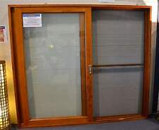 SOLID CEDAR TIMBER SLIDING DOORS WITH FLY SCREEN, 2410W X 2100H, L-R, IN STOCK