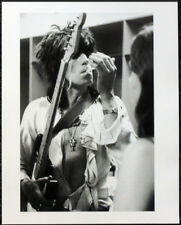 THE ROLLING STONES POSTER PAGE . KEITH RICHARDS LIGHTS A 'CIGARETTE' . R60