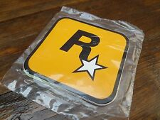 $$$$$ ROCKSTAR GAMES SEALED PACKET OF NINE DIFFERENT COLOUR VINYL STICKERS $$$$$