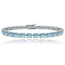 Sterling Silver 14.4ct Blue Topaz 6x4mm Oval Tennis Bracelet