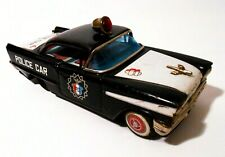 JAPANESE ICHIKO MID-20TH C VINT FRICTION OLDSMOBILE POLICE PATROL TOY CAR #11