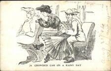 Pretty Woman Has to Sit on Man's Lap Crowded Trolley c1910 Postcard