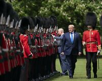 DONALD TRUMP INSPECTS THE GUARD OF HONOR WITH PRINCE CHARLES  8X10 PHOTO (SP077)