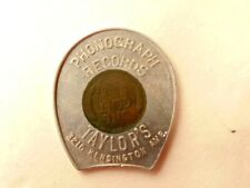 1946 cent set in a good luck token : ad for Taylor's Phonograph Records